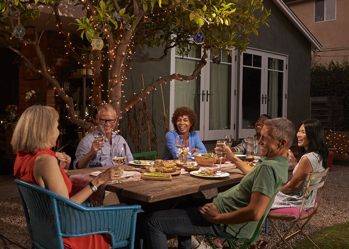 Group Of Mature Friends Enjoying Outdoor Meal In Backyard. Link takes you to the Bank of Versailles Fixed-Rate Mortgages page. Links to the Bank of Versailles Home Loans page.