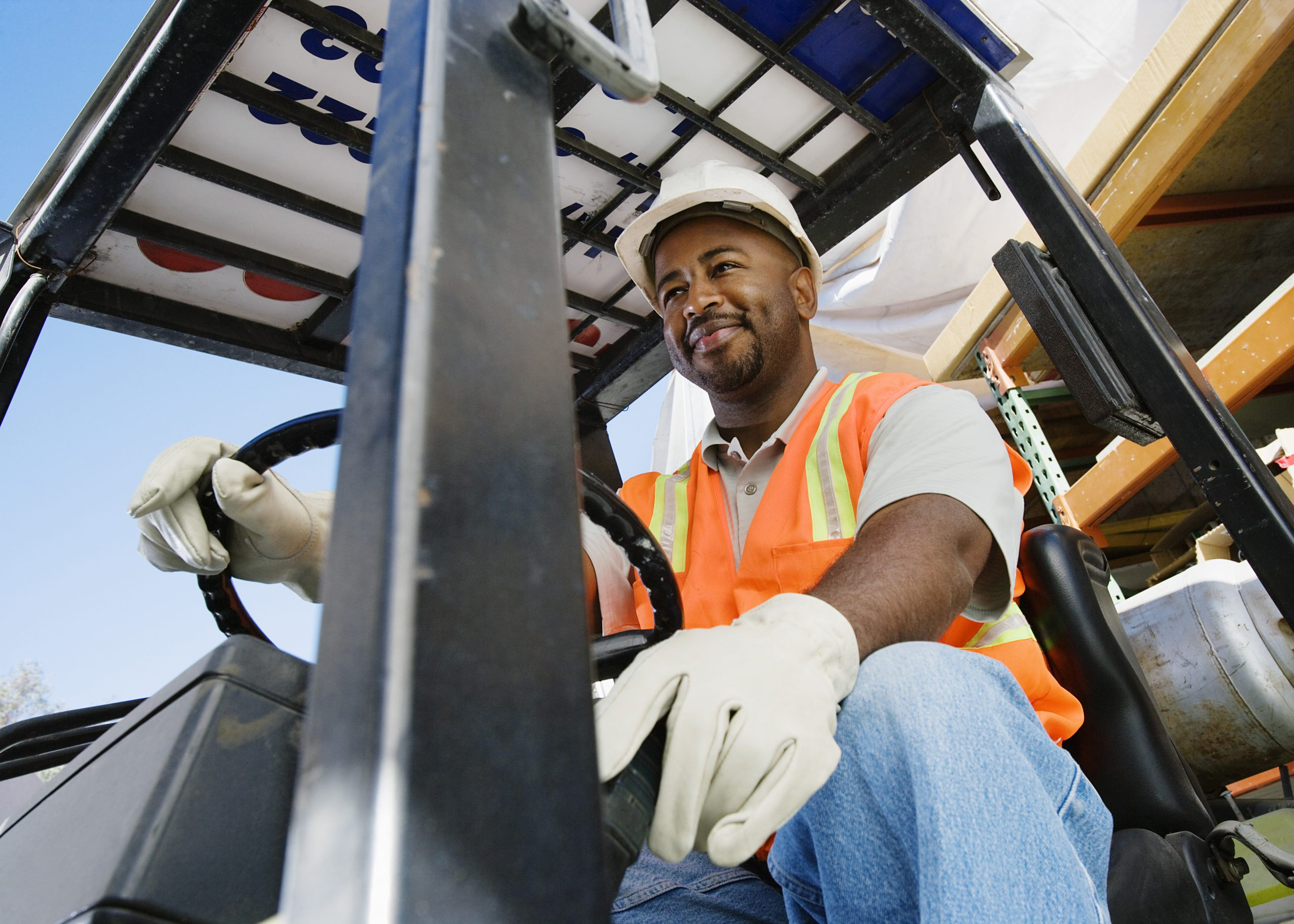 Image of a man operating a forklift. Links to the Bank of Versailles Commercial Loans page.