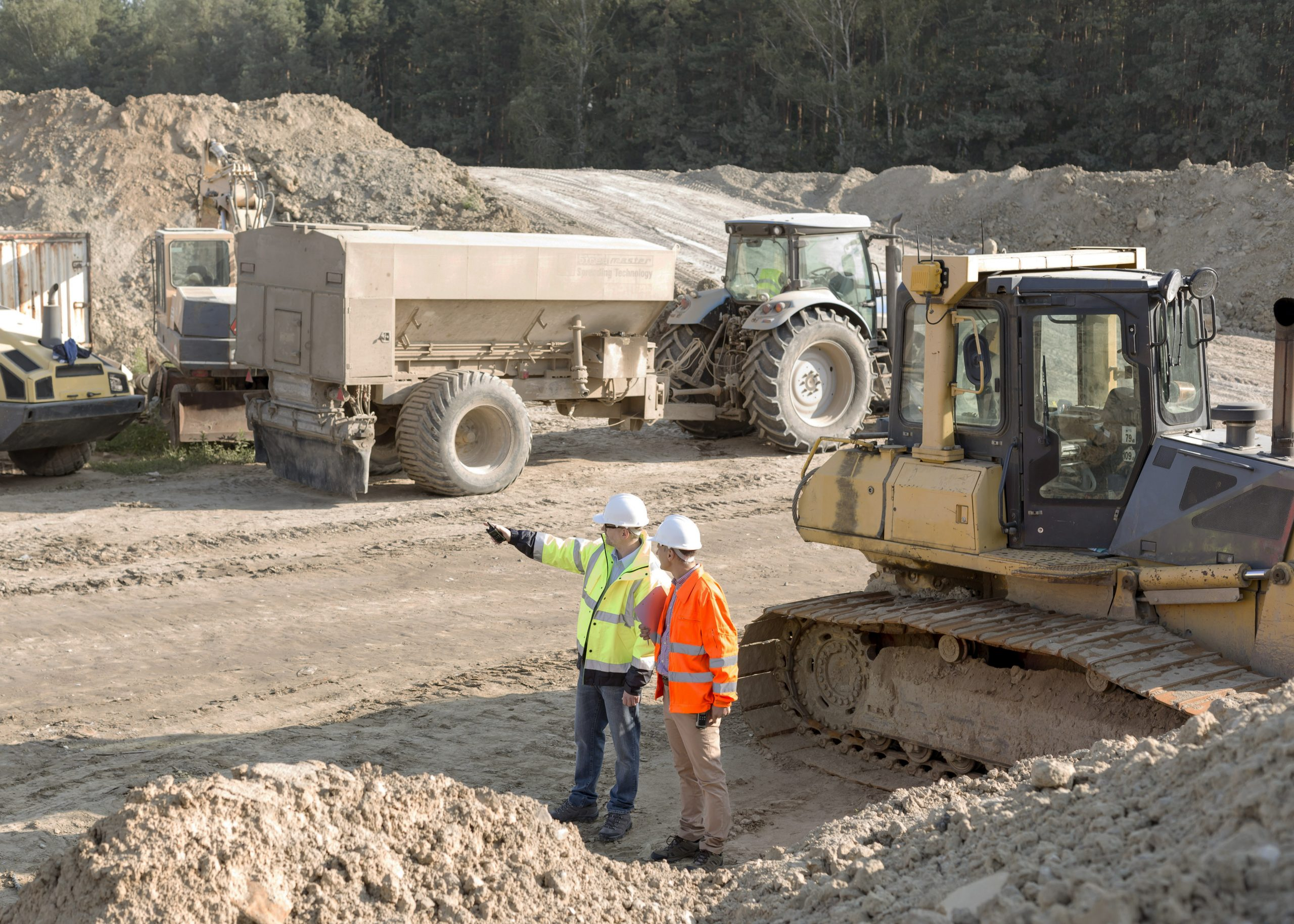 Two men at an excavation site. Link takes you to Business Loans page.