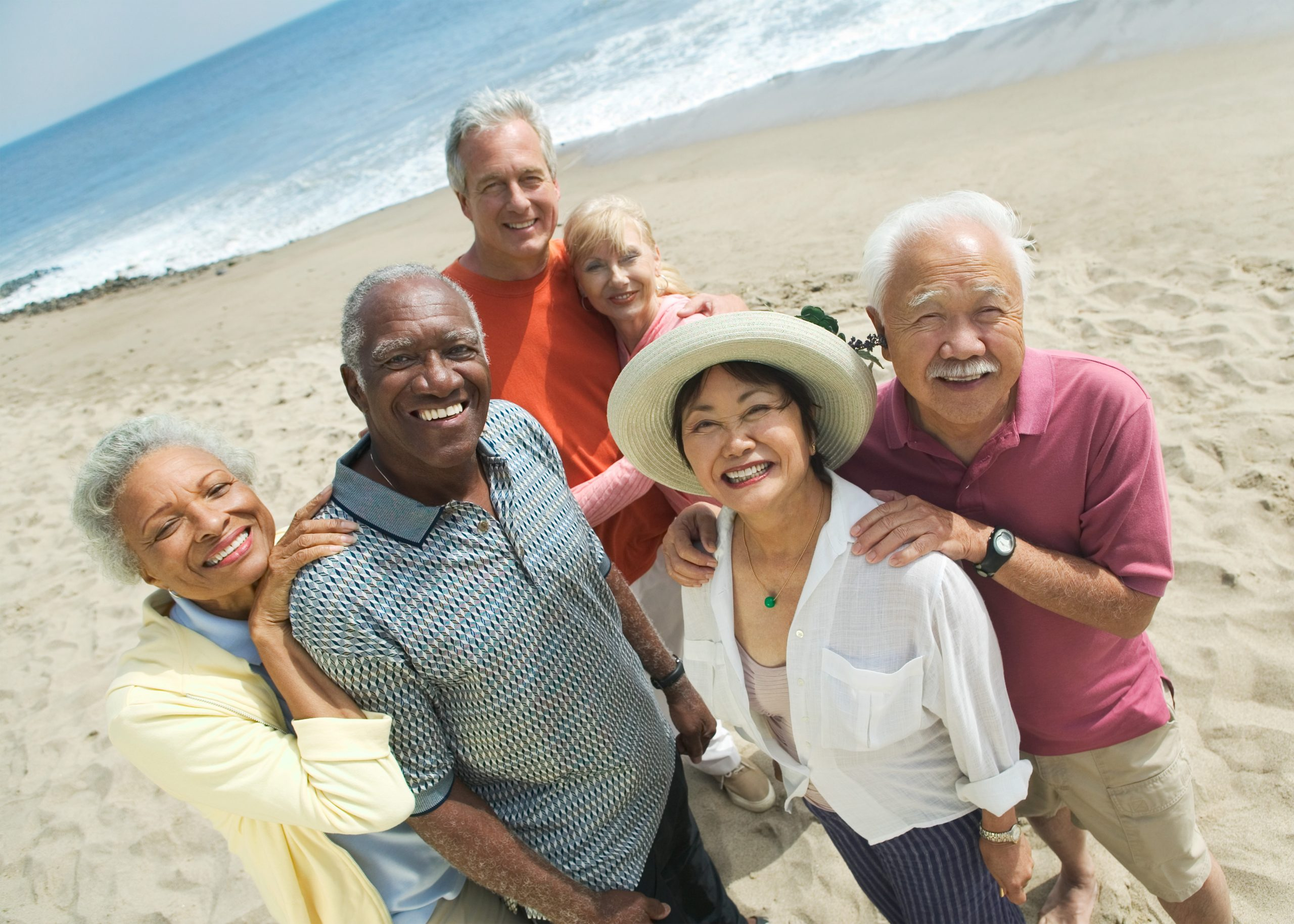 Group of mature, multicultural friends on the beach